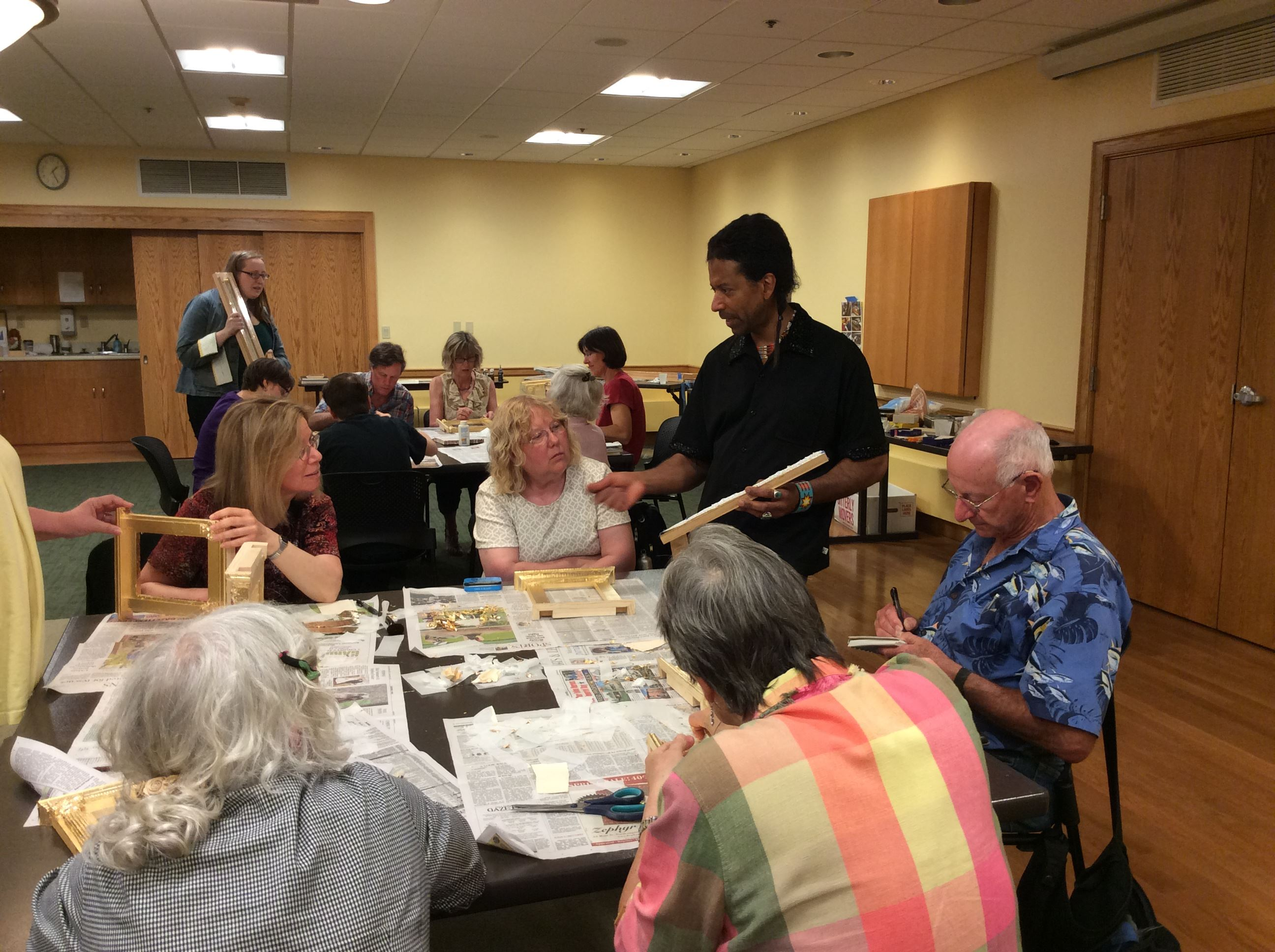Bill Myers demonstrates a decorative technique during the frame gilding workshop