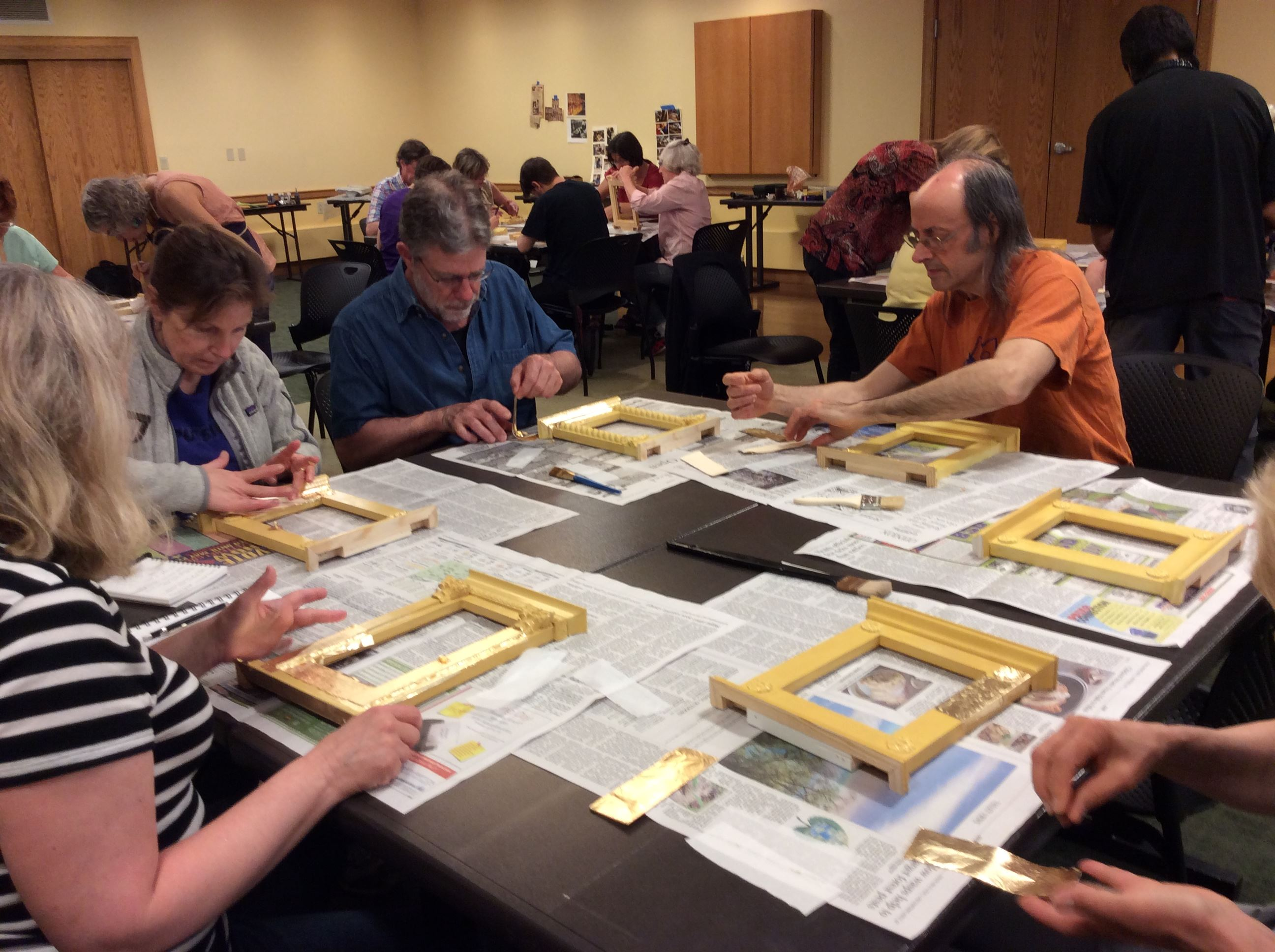 Participants gilding at the frame workshop