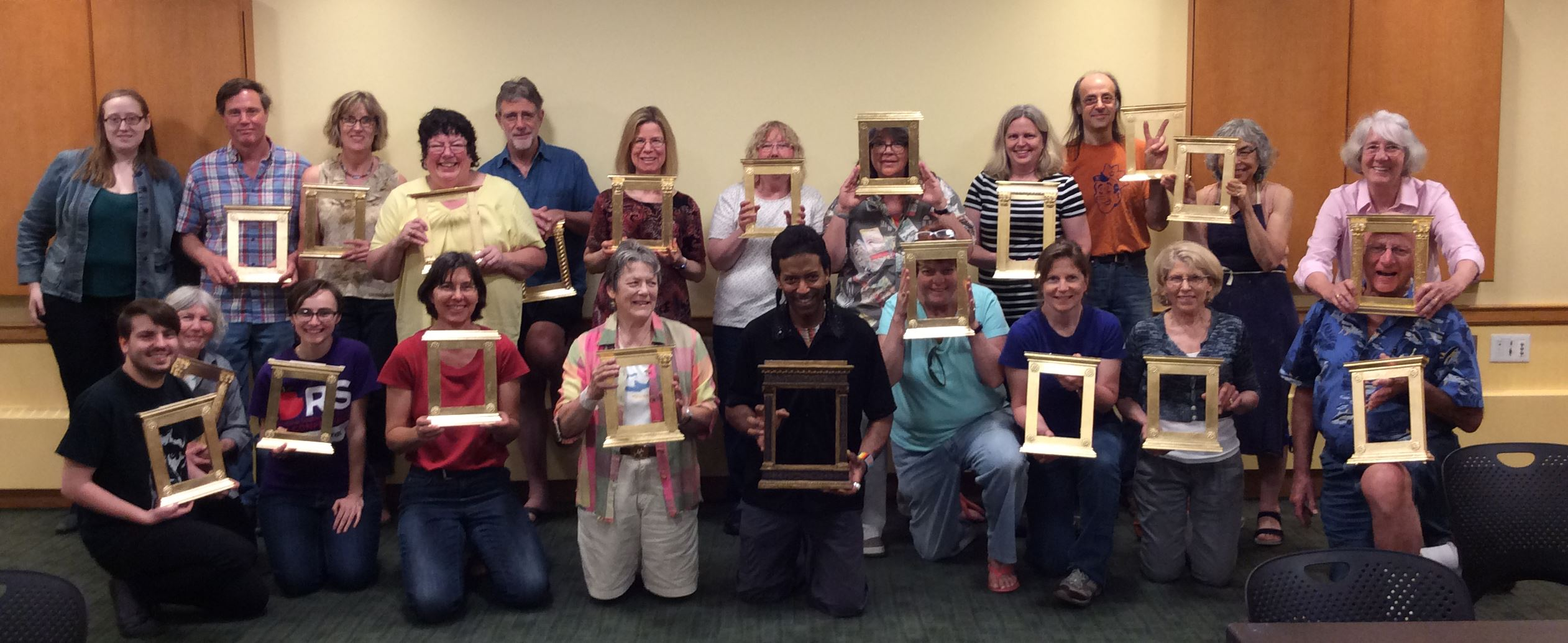 Participants of the frame gilding workshop show off their frames