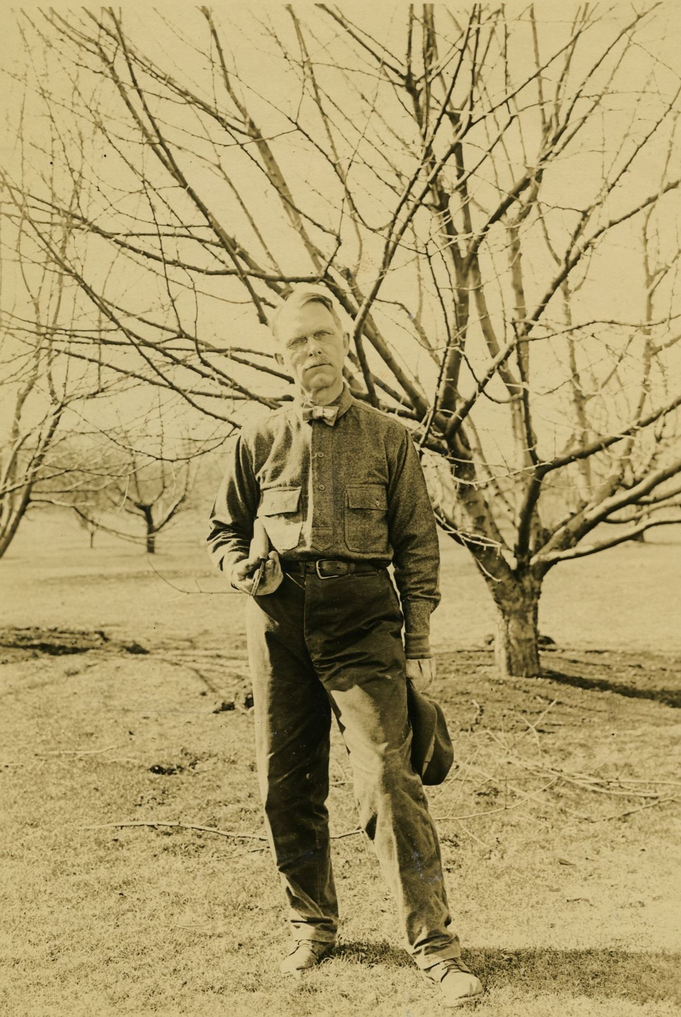 Ray Stannard Baker stands in front of a tree