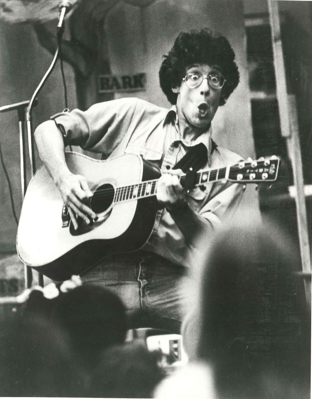 Photograph of an unidentified male musician performing with a guitar