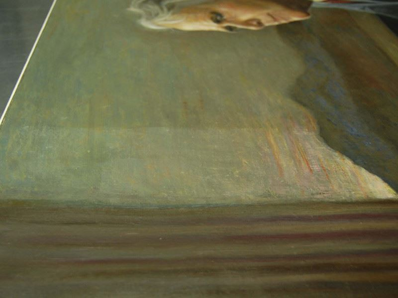 Close-up view of the Portrait of Robert Frost during the cleaning process